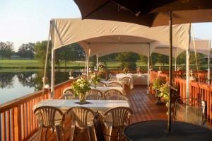 Dining on the 3,000 sq ft Cedar Creek Lodge deck